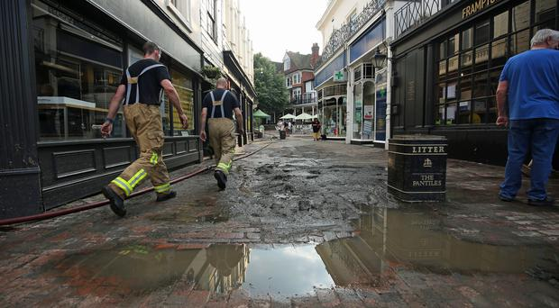 Firefighters work to drain water from The Pantiles in Tunbridge Wells after flash floods (Philip Toscano/PA)