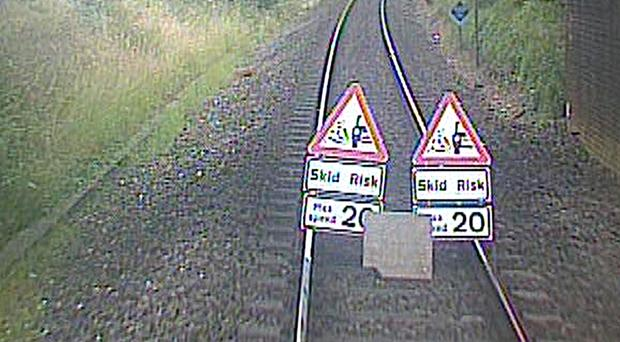 Road signs and a concrete slab placed on train tracks near Feniton (BTPDevonCorn/Twitter/PA)