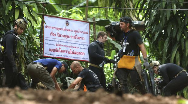 International rescuers prepare to enter the cave where a young football team and their coach are trapped (AP Photo/Sakchai Lalit)