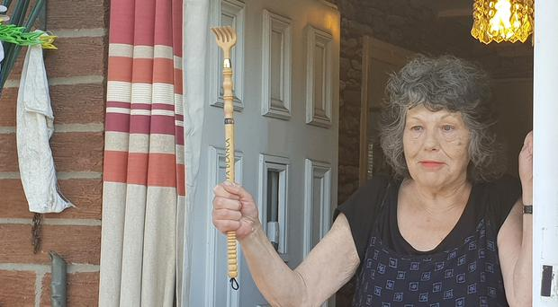 Great-grandmother Joyce Ross holding up the wooden back scratcher she used to confront an intruder (Northumbria Police/PA)