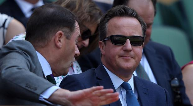 David Cameron in the royal box on centre court (Steve Paston/PA)