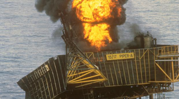 The Piper Alpha platform ablaze days after explosions ripped through the installation off Aberdeen (PA)