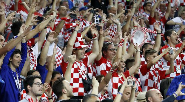 Croatia fans celebrate after winning (Rebecca Blackwell/AP)