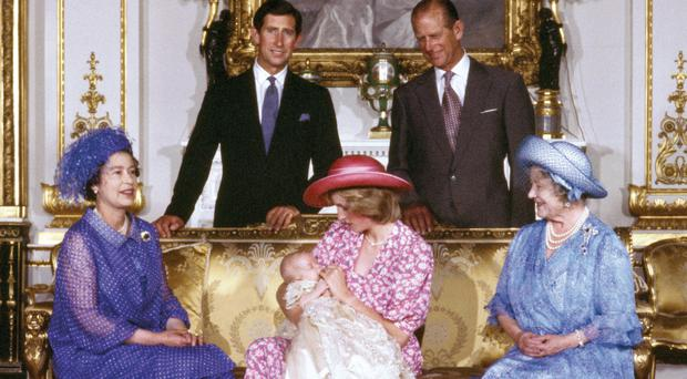 The Princess of Wales holding Prince William after his christening in 1982 (PA)