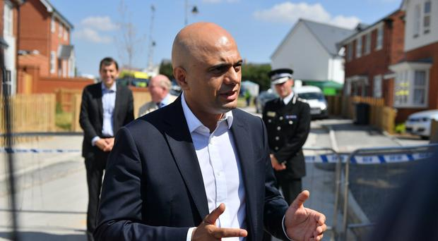 Home Secretary Sajid Javid speaks to the media at Muggleton Road in Amesbury, Wiltshire, where counter-terrorism officers are investigating after a couple were left in a critical condition when they were exposed to the nerve agent Novichok.