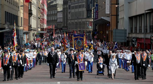 Members of the Orange Order take part in the annual County Grand Orange Order Boyne Parade through Glasgow city centre (Jane Barlow/PA)