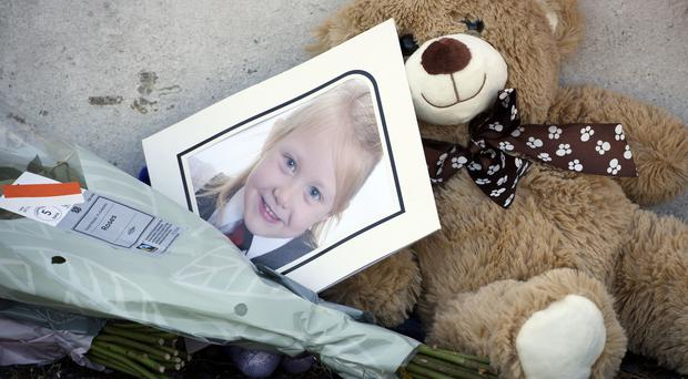 A photograph of Alesha MacPhail among tributes laid for the six-year-old who was found dead on the Isle of Bute last Monday (John Linton/PA)