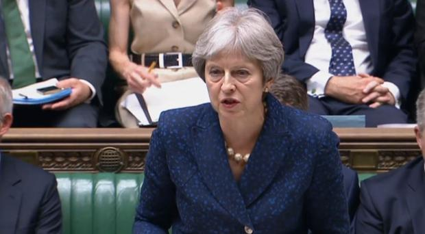 Prime Minister Theresa May updates MPs in the House of Commons (PA)