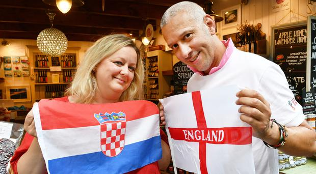Chris Stewart and his Croatian wife Ana-Maria Volaric prepare for the World cup semi-final match at their Taste Croatia food shop in Borough Market in Southwark, south London (John Stillwell/PA)