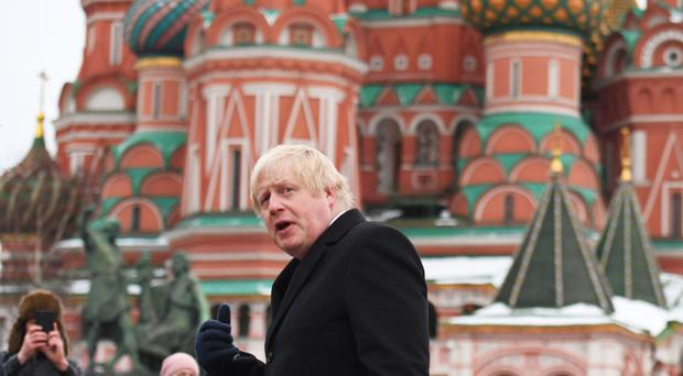 Boris Johnson stands in front of St Basil's Cathedral in Red Square during a visit to Moscow when he was foreign secretary (Stefan Rousseau/PA)
