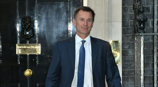 Jeremy Hunt leaves 10 Downing Street, where he was appointed Foreign Secretary (John Stillwell/PA)