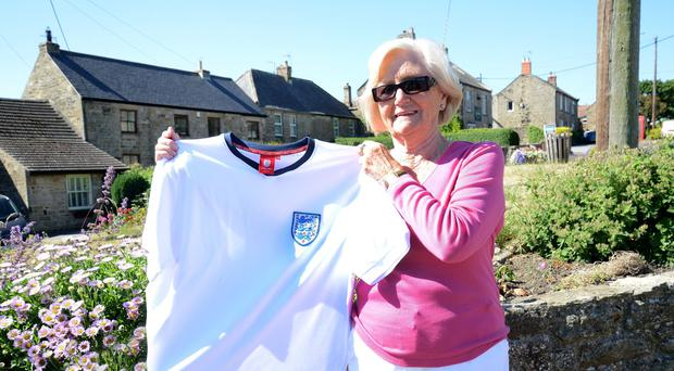 Lady Elsie Robson with an England strip (Sir Bobby Robson Foundation/PA)