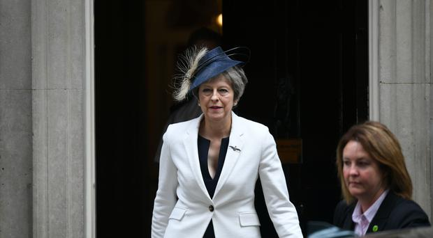 Prime Minister Theresa May leaves Downing Street to attend a service at Westminster Abbey to mark the centenary of the RAF (Stefan Rousseau/PA)