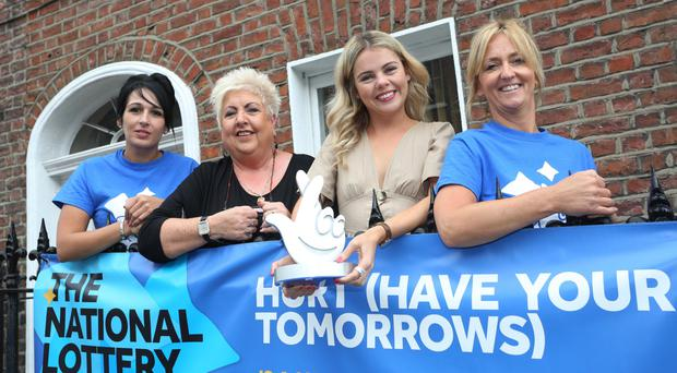 Staff members Tina Burns, Sadie O'Reilly and Pauline McCloskey with Derry Girl Saoirse-Monica Jackson (second right)