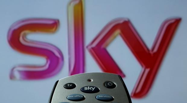 Rupert Murdoch's 21st Century Fox has hiked its bid to take full control of Sky to £14.9 billion as it looks to beat rival suitor Comcast in the battle for the pay TV giant (Chris Radburn/PA)