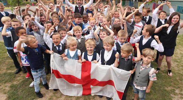 Pupils and staff from Minister Church of England Primary School in Ramsgate Kent show their support for Gareth Southgate and England in the World Cup semi-final