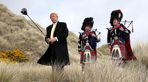 Donald Trump swings a golf club on the Menie Estate near Balmedie (Andrew Milligan/PA)