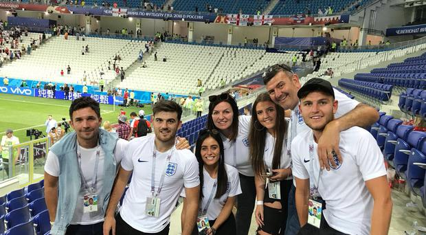Undated handout photo courtesy of former Norwich goalkeeper Bryan Gunn of the family entourage of Leicester City star and England defender 25-year-old Harry Maguire, who went to the last major football tournament as a Three Lions fan. (left to right) Kenneth Shepherd (MaguireÕs agent), brother Joe, Fern Hawkins (MaguireÕs girlfriend, kneeling), mother Zoe, sister Daisy, dad Alan and brother Laurence.