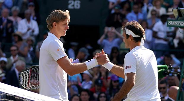 Kevin Anderson (left) shakes hands with Roger Federer (John Walton/PA)
