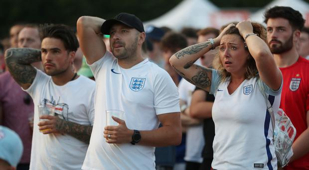 England fans watch the game at Nottingham Castle (David Davies/PA)