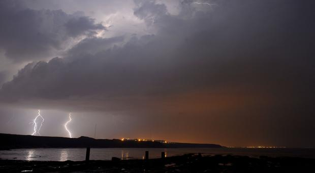 The Met Office has issued a yellow thunderstorm warning for some areas (Owen Humphreys/PA)