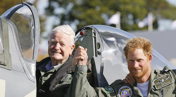 Wing Commander Tom Neil, who has died aged 97, met Prince Harry during Battle of Britain commemorations (Kirsty Wigglesworth/PA)
