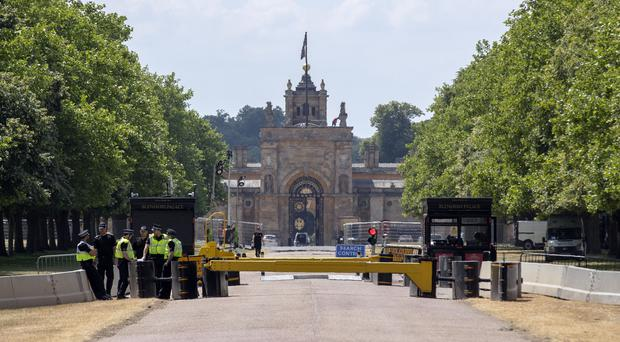Thames Valley Police officers outside an entrance to Blenheim Palace near Woodstock, Oxfordshire (Steve Parsons/PA)