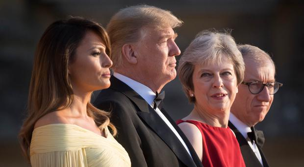 Donald and Melania Trump with Theresa May and husband Philip at Blenheim Palace (Stefan Rousseau/PA)