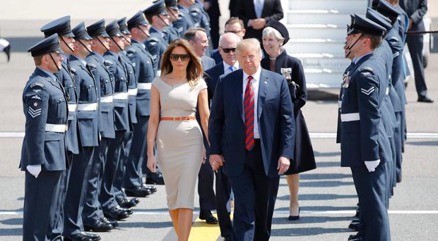 President Trump and First Lady Melania are greeted by an RAF honour guard at Stansted airport