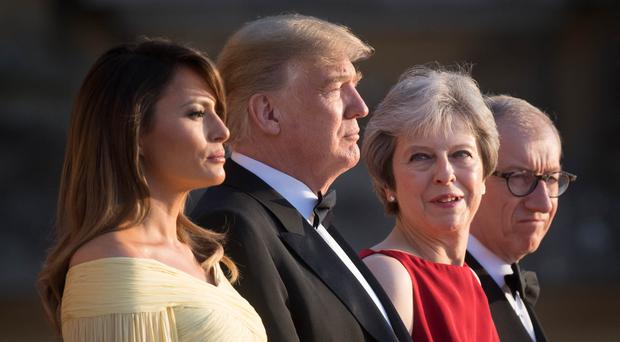 US President Donald Trump and his wife Melania are welcomed by Prime Minister Theresa May and her husband Philip May at Blenheim Palace (Stefan Rousseau/PA)