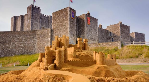 English Heritage has created the 'ultimate sandcastle' with 29 tonnes of sand outside Dover Castle in Kent (English Heritage/PA)
