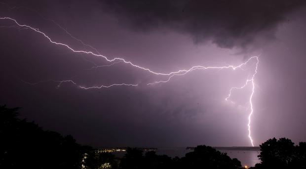Lightning strikes over Poole harbour in Dorset (Martin Keene/PA)