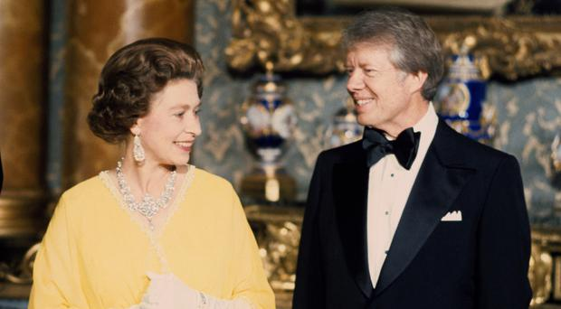The Queen meets Jimmy Carter at Buckingham Palace (PA)