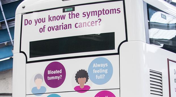 A double-decker bus a advert highlighting the symptoms of ovarian cancer (Lothian/Target Ovarian Cancer/PA)