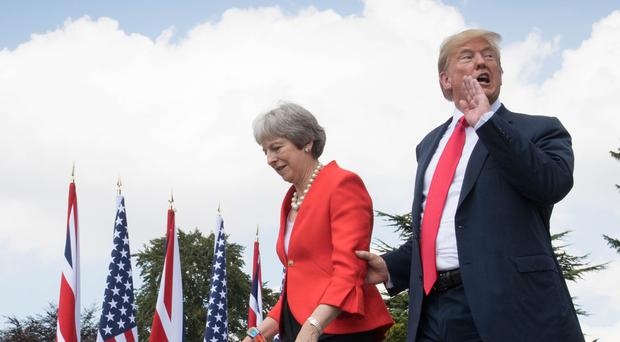 US President Donald Trump walks with Prime Minister Theresa May prior to a joint press conference at Chequers, her country residence in Buckinghamshire (PA)