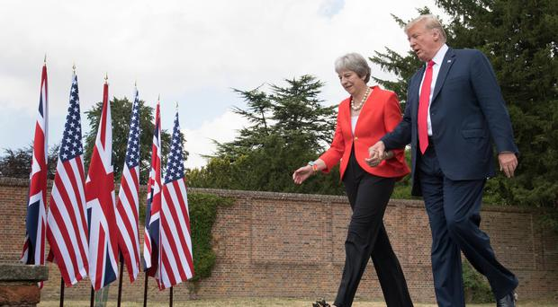 Donald Trump walks with Theresa May at Chequers (Stefan Rousseau/PA)