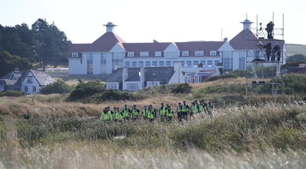 Police patrol the sand dunes outside Turnberry, where President Donald trump is staying on his visit to Scotland (Jane Barlow/PA)