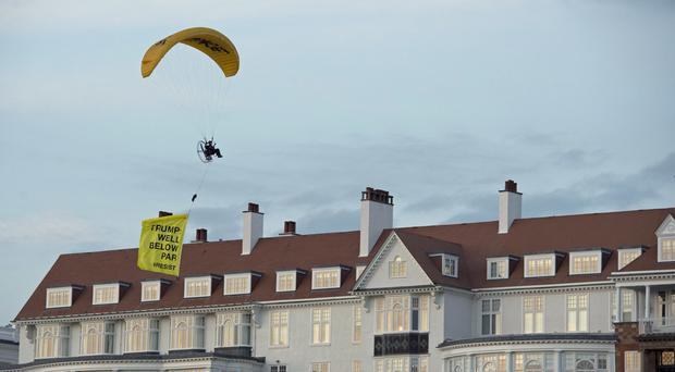 Police Scotland have launched an investigation after a protesting paraglider flew over Turnberry. (john Linton/PA)