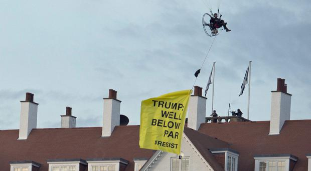 A Greenpeace protester flying a microlight passes over Donald Trump's resort in Turnberry (John Linton/PA)