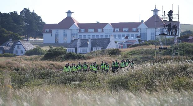 Police patrol the sand dunes at the Trump Turnberry resort in South Ayrshire, where US President Donald Trump and first lady Melania Trump are spending the weekend (Jane Barlow/PA)