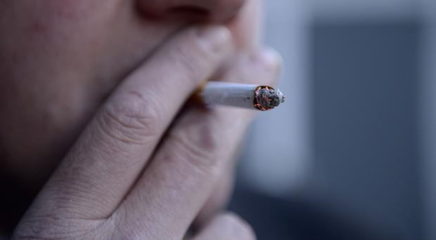 File photo dated 12/03/13 of a man smoking a cigarette, as the British Lung Foundation finds there has been a 75% decline in stop smoking aids being prescribed by GPs.