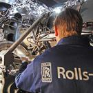 A Rolls-Royce of a worker with the company's MT30 engine (Rolls-Royce/PA)