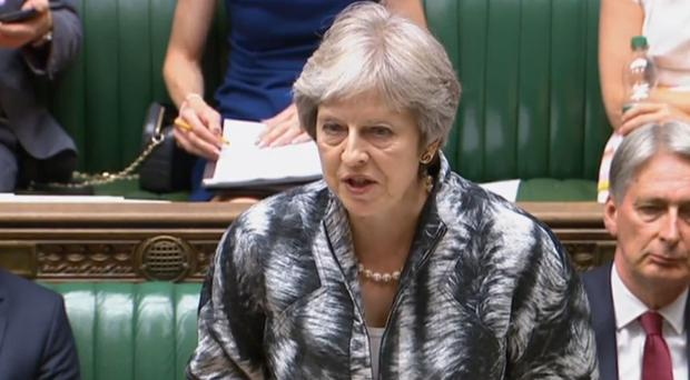 Prime Minister Theresa May giving a statement in the House of Commons (PA Wire/PA Images)