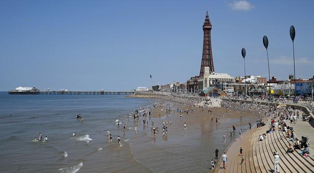 Blackpool saw 14mm of rain, but the warm weather is predicted to continue (Martin Rickett/PA)