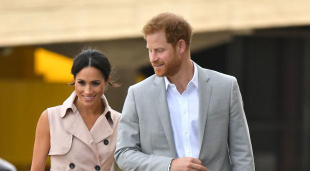 Harry and Meghan arrive for their visit to the Nelson Mandela centenary exhibition (Dominic Lipinski/PA)