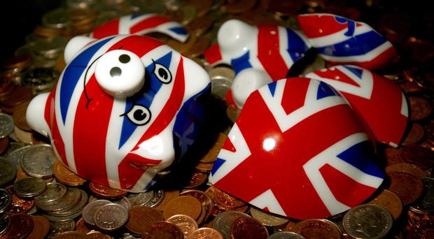 Tax hikes and spending cuts worth an extra £39 billion every decade for the next 50 years would be needed to prevent ballooning national debt levels, the UK's fiscal watchdog has warned.