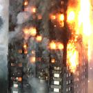 File photo dated 01/01/2018 of the Grenfell Tower fire in London. A ban on flammable cladding for new high-rise buildings being considered by the Government in the wake of the Grenfell Tower tragedy does not go far enough, a Commons committee has warned.