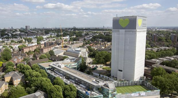 Grenfell Tower, covered in plastic sheeting (Rick Findler/PA)