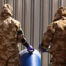 Investigators in chemical suits (Yui Mok/PA)