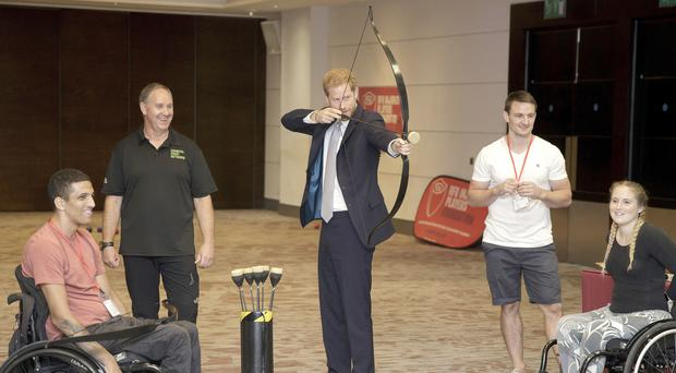 The Duke of Sussex tries archery during a visit to the RFU Injured Players Foundation's annual Client Forum at Twickenham Stadium (Tim Ireland/PA)